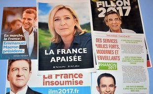 Des affiches non officielles des candidats à l'élection présidentielle 2017 à  Bourgoin-Jallieu, en mars 2017.
