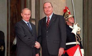 Vladimir Poutine et Jacques Chirac, en octobre 2000 à Paris.