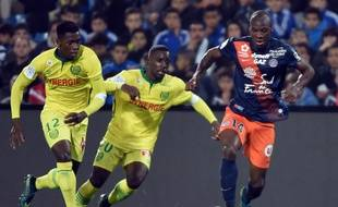 Montpellier's French midfielder Bryan Dabo (R) vies with Nantes' French forward Jules Iloki (C) and Nantes' Malian midfielder Birama Toure during the French L1 football match between MHSC Montpellier and Nantes on November 07, 2015, at the la Mosson Stadium in Montpellier, southern France.  AFP PHOTO / PASCAL GUYOT