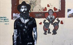 Street art, acrylique sur craft noir et blanc de Neiluj (à gauche)