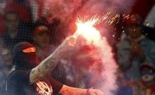 Un hooligan serbe, lors de du match Italie - Serbie, le 13 octobre 2010 à Gênes.