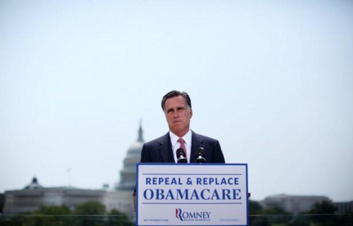 Le candidat républicain à la Maison Blanche, Mitt Romney, a répété jeudi qu'il abolirait la réforme de la santé de Barack Obama dès son premier jour à la tête des Etats-Unis s'il bat en novembre le président sortant. – Alex Wong afp.com