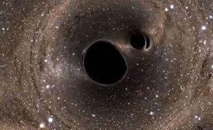 Capture d'écran d'une vidéo modélisant la fusion de deux trous noirs.