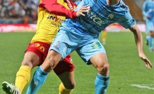Le milieu Benoît Cheyrou (en bleu) a offert la victoire aux Marseillais.