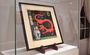 Vente aux enchères L'univers du créateur de Tintin : la couverture du «Lotus bleu» d'Hergé aux enchères. La maison Artcurial sur les Champs-Elysees a Paris met aux encheres jeudi le genial dessin cree par Herge en 1936 pour la couverture du Lotus bleu, estimee entre 2,2 et 2,8 millions d euros
