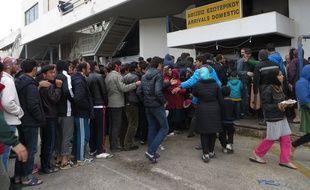 Des réfugiés à l'aéroport d'Athènes, en Grèce.