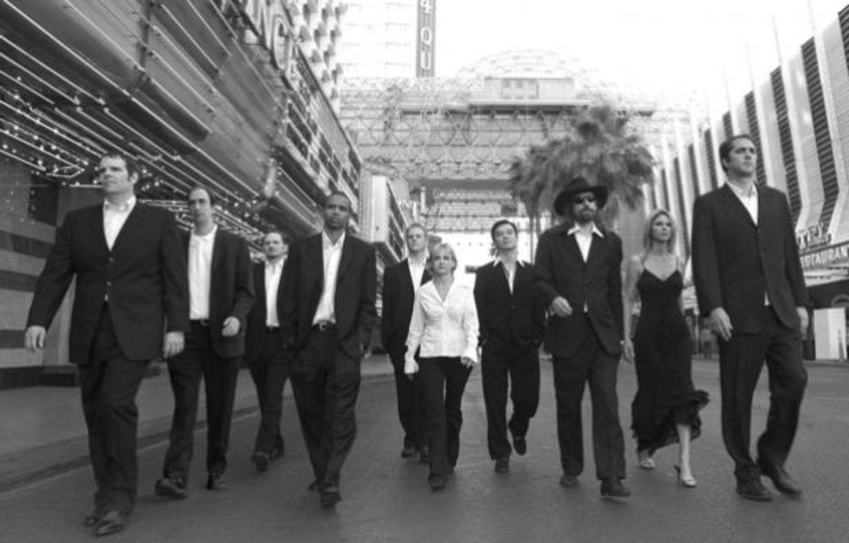 Full Tilt et ses dirigeants, dont les joueurs de poker professionnels Howard Lederer (1er en partant de la gauche) et Chris Ferguson (3e en partant de la droite), auraient pu jouer dans Reservoir Dogs – Full Tilt Poker