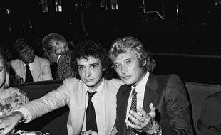 Michel Sardou et Johnny hallyday lors du du diner d'ouverture de l'Elysées Matignon. Paris, FRANCE - 16/09/1977