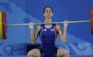 L'haltérophile française Mélanie Noël, lors des Jeux Olympiques de Pékin, le 9 août 2008.