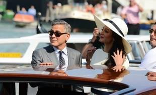 George Clooney et sa femme Amal Alamuddin le 20 septembre 2014 à Milan, en Italie.
