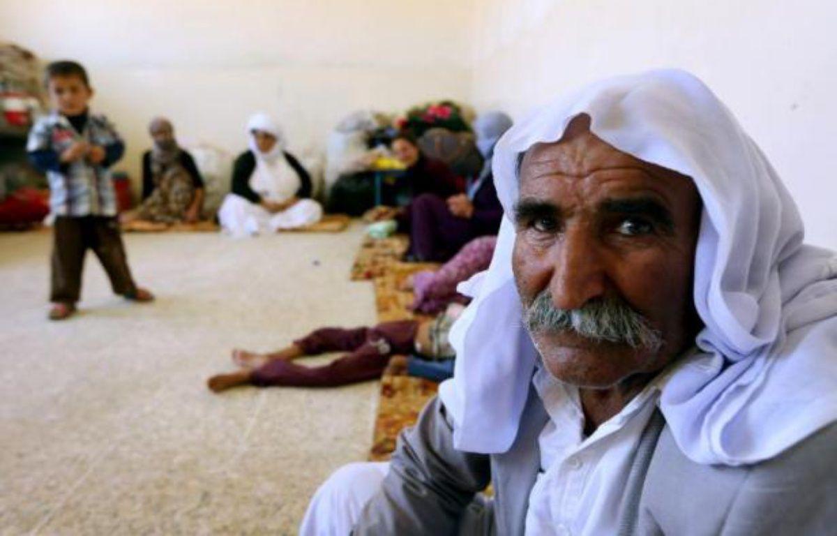 Une famille yazidie qui a fui la violence de son village de Sinjar en Irak, réfugiée dans une école au Kurdistan, le 5 août 2014 – Safin Hamed AFP