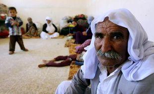 Une famille yazidie qui a fui la violence de son village de Sinjar en Irak, réfugiée dans une école au Kurdistan, le 5 août 2014