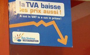 L'autocollant officiel signalant une baisse des prix dans la restauration à partir du 1er juillet 2009.