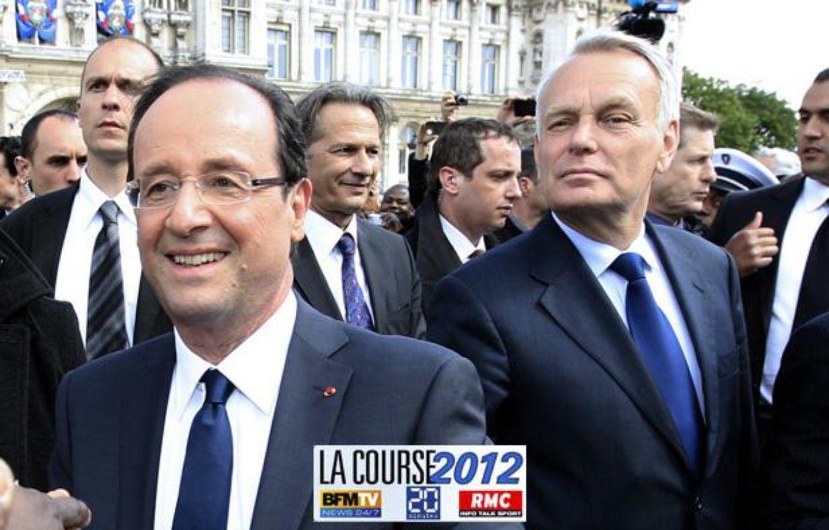 François Hollande et Jean-Marc Ayrault le 15 mai 2012, jour de l'investiture du président de la République. – PASCAL ROSSIGNOL / POOL / AFP