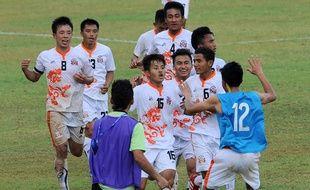 Les joueurs de l'équipe du Bhoutan célèbrent leur victoire contre le Sri Lanka, le 12 mars 2015, à Colombo.