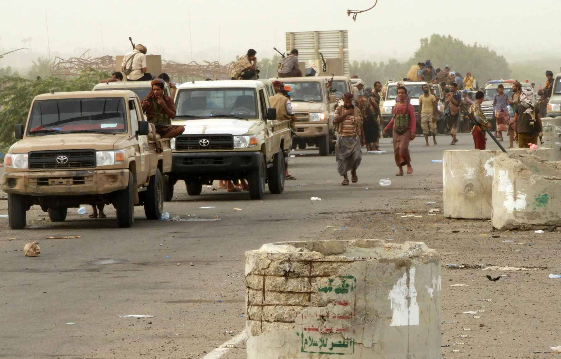 Yemeni pro-government forces arrive in al-Durayhimi district, about nine kilometres south of Hodeidah international airport on June 13, 2018. Yemeni forces backed by the Saudi-led coalition launched an offensive on June 13 to retake the rebel-held Red Sea port city of Hodeida, pressing toward the airport south of the city. The port serves as the entry point for 70 percent of the impoverished country's imports as it teeters on the brink of famine.