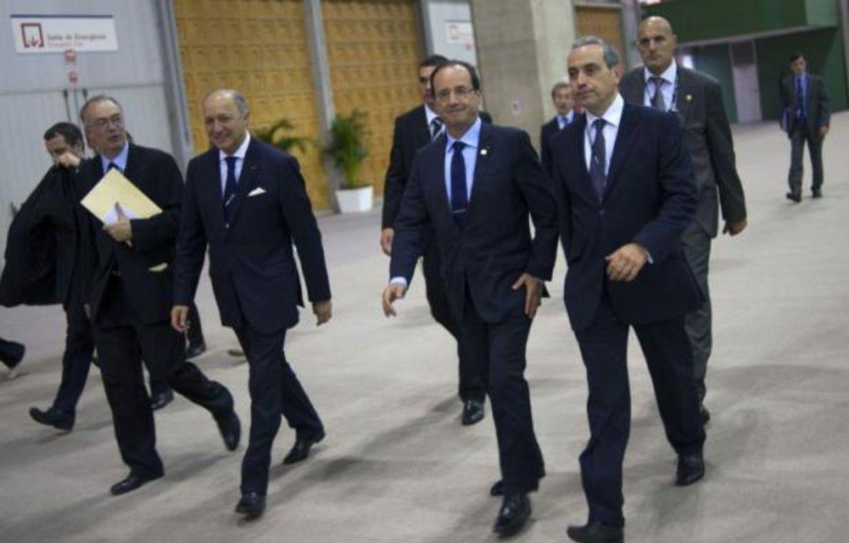 """Le président français François Hollande a jugé mercredi que l'accord arraché lors du sommet Rio+20 constituait une """"étape"""" mais a réclamé à ses partenaires un """"sursaut"""" pour faire avancer la """"grande cause"""" de l'environnement et du développement durable. – Fred Dufour afp.com"""