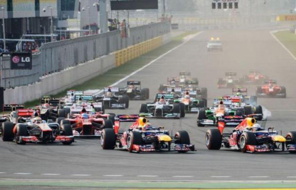 L'Allemand Sebastian Vettel (Red Bull) a remporté le Grand Prix de Corée du Sud, 16e manche du Championnat du monde de Formule 1, devant son coéquipier australien Mark Webber et l'Espagnol Fernando Alonso (Ferrari), dimanche sur le circuit de Yeongam, au sud de Séoul. – Philippe Lopez afp.com