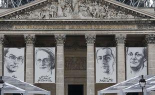 Les portraits de Jean Zay, Genevieve de Gaulle-Anthonioz, Pierre Brossolette et Germaine Tillion, sont affichés sur la façade du Panthéon, à Paris, le 26 mai 2015.