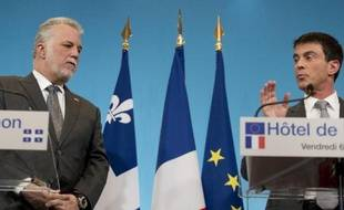 Les Premiers ministres français et québécois, Manuel Valls et Philippe Couillard à l'Hôtel Matignon à Paris le 6 mars 2015