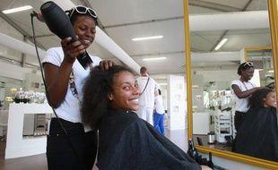 Sarah Hanffou au coiffeur du village olympique, le 27 juillet 2012, à Londres.