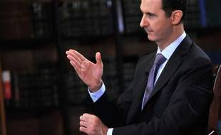 Photo fournie le 29 septembre 2013 par l'agence Sana montrant le président syrien Bachar al-Assad interviewé la veille par une télévision italienne