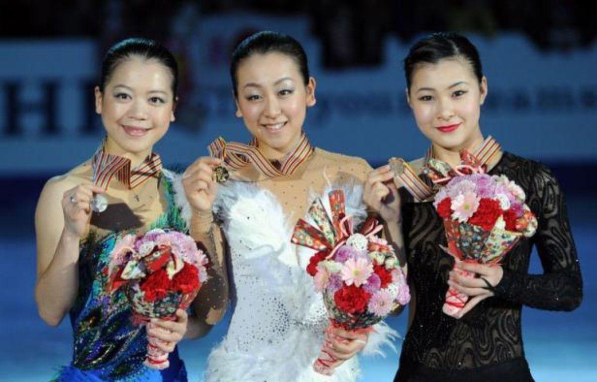 La Japonaise Mao Asada, en tête à l'issue du programme court, a remporté l'épreuve dames des Championnats des Quatre continents de patinage artistique après son succès sur le programme libre disputé dimanche à Osaka (Japon). – Toshifumi Kitamura afp.com
