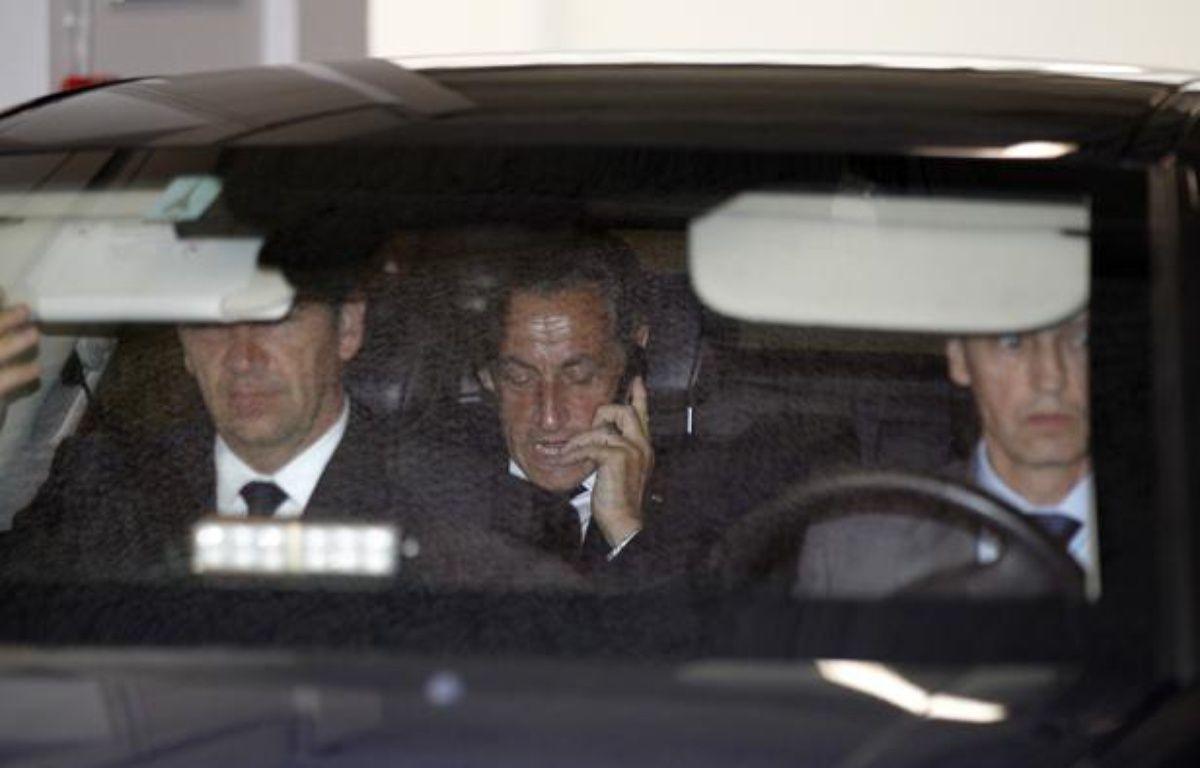 Nicolas Sarkozy quitte ses bureaux parisiens en voiture, le 4 juin 2012. – T.SAMSON / AFP