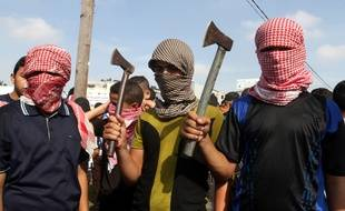 Palestinians take part in an anti-Israel protest in the southern Gaza Strip town of Rafah on October 13, 2015, as a wave of stabbings has hit Israel, Jerusalem and the West Bank along with violent protests in annexed east Jerusalem and the occupied West Bank, leading to warnings that a full-scale Palestinian uprising, or third intifada, could erupt. The unrest has also spread to the Gaza Strip, with clashes along the border in recent days leaving nine Palestinians dead from Israeli fire. Photo by Abed Rahim Khatib/APAIMAGES_123401/Credit:APA IMAGES/SIPA/1510131239