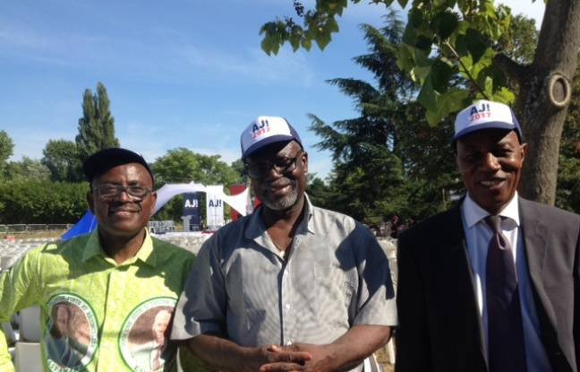 Nestor Koffi, Sam Dibi et Zébré Samuel Souhoure, militants au rassemblement d'Alain Juppé à Chatou (Yvelines) le 27 août 2016.