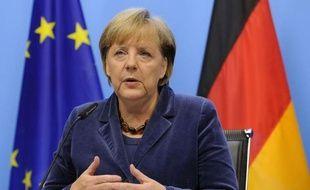 Nicolas Sarkozy, la chancelière allemande Angela Merkel, la directrice générale du FMI Christine Lagarde et le chef de file des ministres des Finances de la zone euro Jean-Claude Juncker ont dû intervenir personnellement dans la nuit pour trouver un compromis avec les banques, alors que les discussions étaient enlisées.