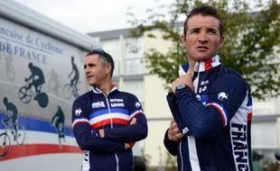 Thomas Voeckler et Laurent Jalabert (au second plan), après un entraînement à Valkenburg (Pays-Bas) le 18 septembre 2012.