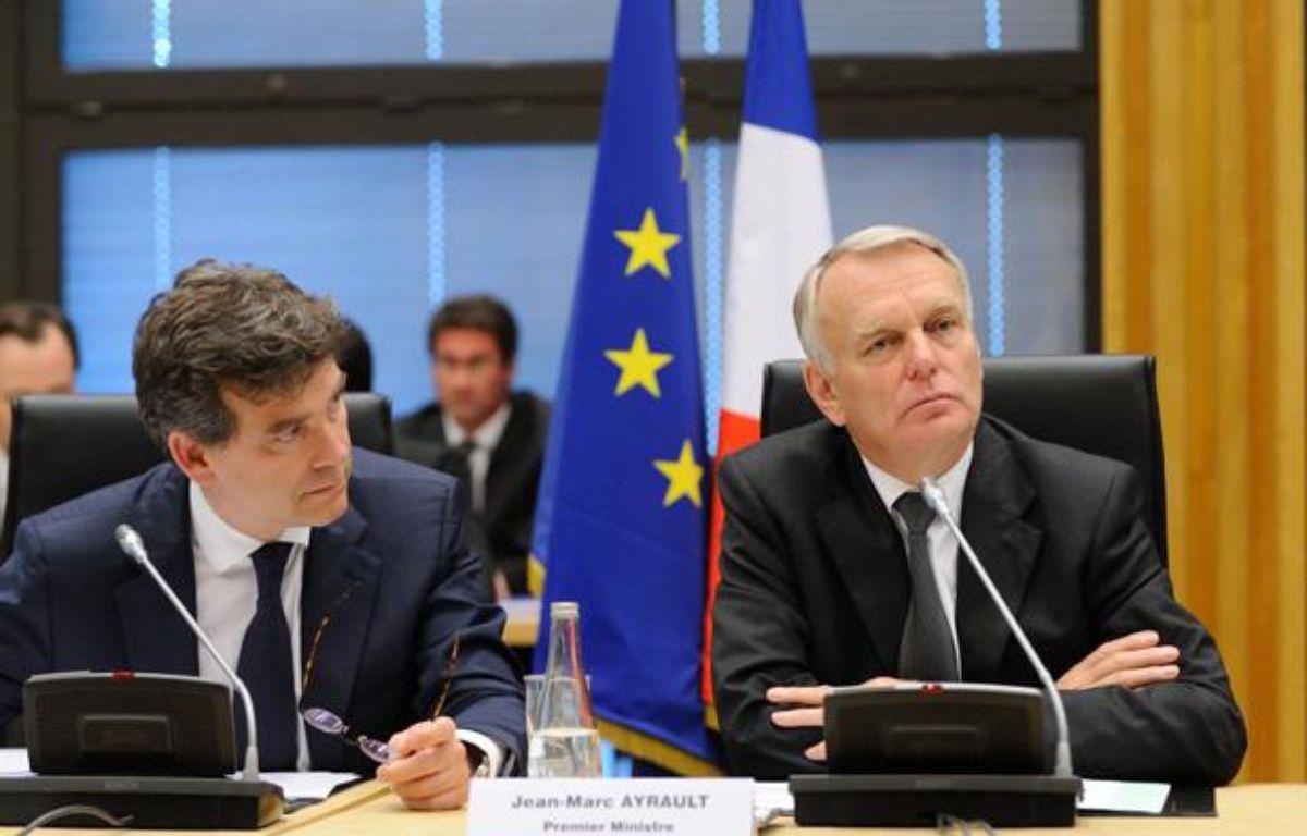 Arnaud Montebourg et Jean-Marc Ayrault à l'ouverture de la Conférence nationale pour l'industrie le 11 juillet 2012. – WITT/SIPA