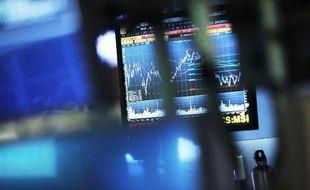 """Wall Street a terminé la séance de vendredi sur une légère baisse, suite aux déclarations de la présidente de la Fed Janet Yellen évoquant un risque de """"surchauffe"""" de l'économie si les taux d'intérêt étaient relevés trop tard"""