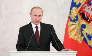 """Vladimir Poutine a défendu jeudi sa vision d'une Russie à la responsabilité """"historique"""" dans un monde instable, rempart à l'hégémonie américaine et garante des valeurs traditionnelles face à la déchéance du monde occidental."""