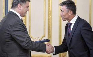 Le secrétaire général de l'Otan, Anders Fogh Rasmussen reçu le 7 août 2014 par le président ukrainien Petro Porochenko