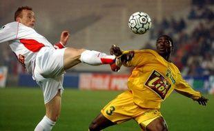 Shiva Star N'Zigou face au Nancéien Sébastien Puygrenier (avec des cheveux) en 2003.