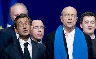 Nicolas Sarkozy (G) et Alain Juppé le 7 février 2015 à Paris