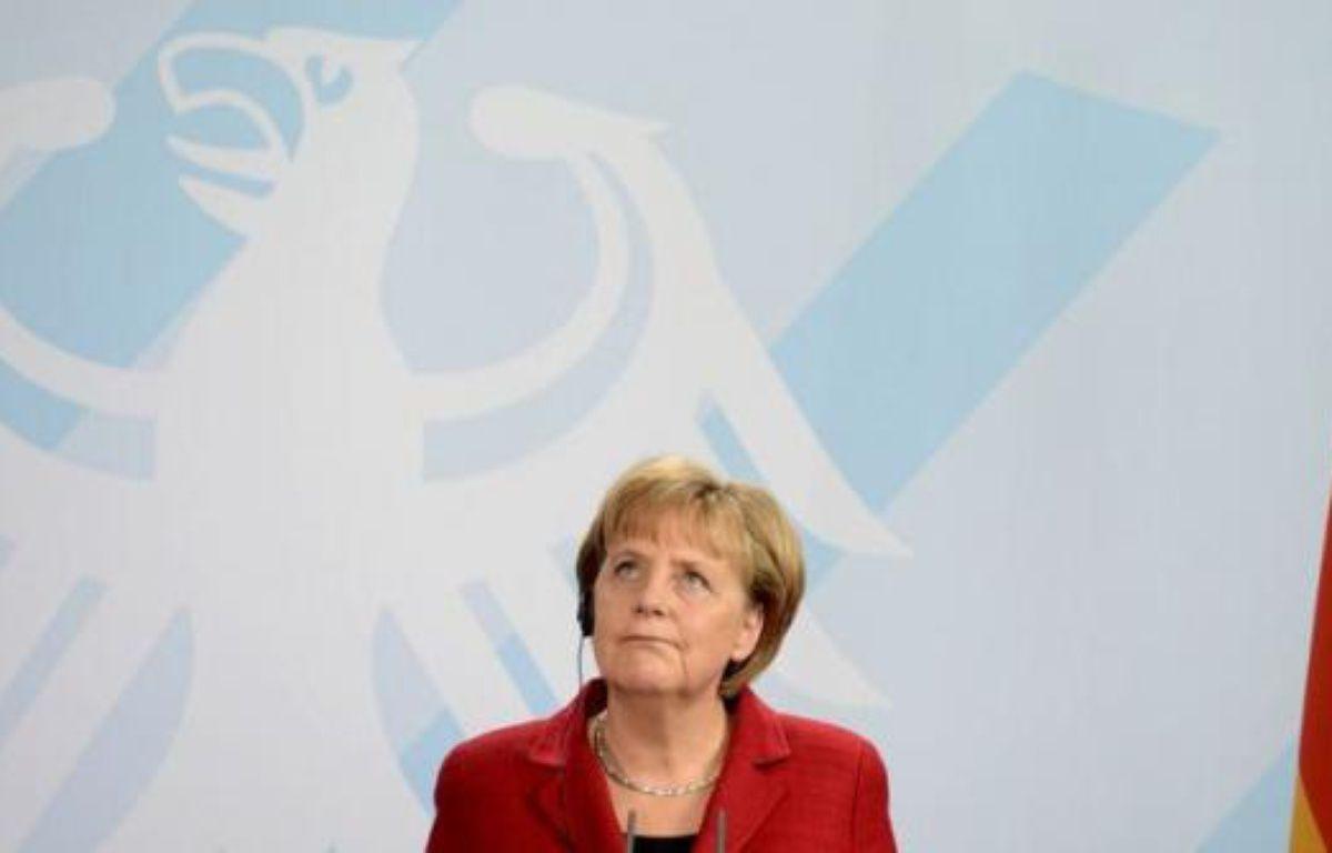 Tous les pays ayant signé le pacte budgétaire doivent respecter cet accord, a déclaré mercredi la chancelière allemande Angela Merkel, semblant s'adresser à la France et la Grèce, lors d'une conférence de presse à Berlin – Odd Andersen afp.com