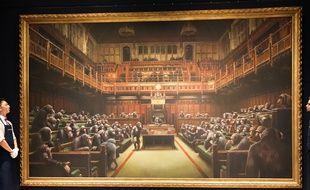 Présentation de la toile de Banksy chez Sotheby's à Londres le 27 septembre 2019.