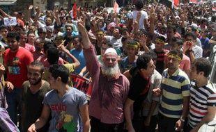 Des partisans des Frères musulmans manifestent au Caire, un an jour pour jour après la destitution par l'armée du président islamiste Mohamed Morsi, le 3 juillet 2014