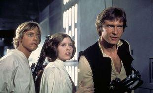 Star Wars (La guerre des étoiles) Mark Hamill, Carrie Fisher, et Harrison Ford, 1977.