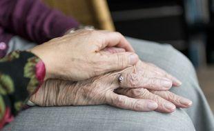 Illustration d'une personne prenant soin d'une personne âgée.