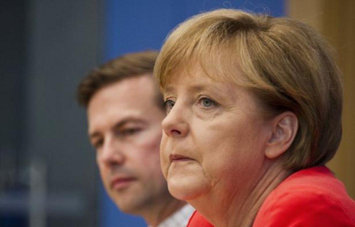 L'Allemagne va ratifier le pacte budgétaire européen et le fonds de secours MES, après qu'Angela Merkel a fait jeudi des concessions marginales à l'opposition en matière de croissance et de taxation des marchés. – John Macdougall afp.com