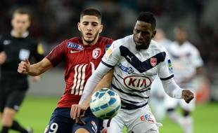 Yassine Benzia, ici au duel la saison passée avec l'ancien milieu bordelais André Poko.