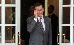 """Le chef du gouvernement espagnol Mariano Rajoy a affirmé dimanche avoir, par son travail de réformes, évité """"une intervention extérieure"""" pour l'économie du pays, limitant sa demande d'aide européenne à son secteur financier."""