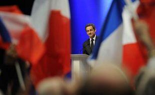 """Nicolas Sarkozy (UMP) estime que la parité """"ne se limite pas"""" au gouvernement et doit s'exercer dans la vie quotidienne des Françaises, disant vouloir créer davantage de solutions de garde des enfants."""