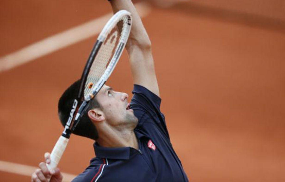 Novak Djokovic dans son match précédent contre Nicolas Devilder le 1er juin 2012. – KENZO TRIBOUILLARD / AFP