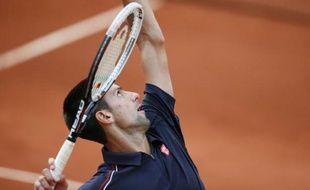 Novak Djokovic dans son match précédent contre Nicolas Devilder le 1er juin 2012.