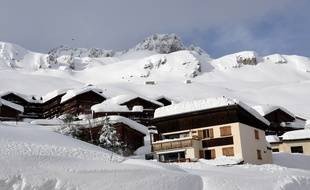 A picture taken on January 9, 2018 shows chalets covered with snow in Tignes ski station, in the French Alps.